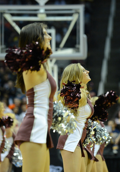 March 21, 2013: Montana Grizzlies cheerleaders perform in a timeout during a game between the Syracuse Orangemen and the Montana Grizzlies in the second round of the NCAA Division I Men's Basketball Championship at HP Pavilion in San Jose, California.