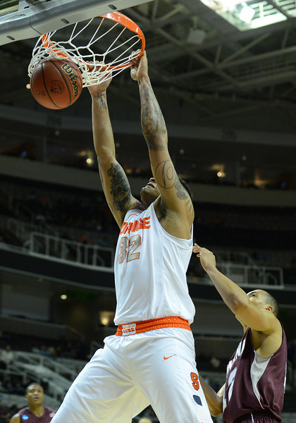 March 21, 2013: Syracuse Orange forward DaJuan Coleman (32) dunks during a game between the Syracuse Orangemen and the Montana Grizzlies in the second round of the NCAA Division I Men's Basketball Championship at HP Pavilion in San Jose, California.