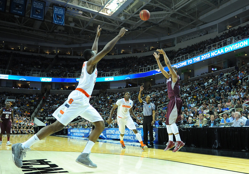 March 21, 2013: A Syracuse Orange defender closes out on a Montana Grizzlies shooter during a game between the Syracuse Orangemen and the Montana Grizzlies in the second round of the NCAA Division I Men's Basketball Championship at HP Pavilion in San Jose, California.