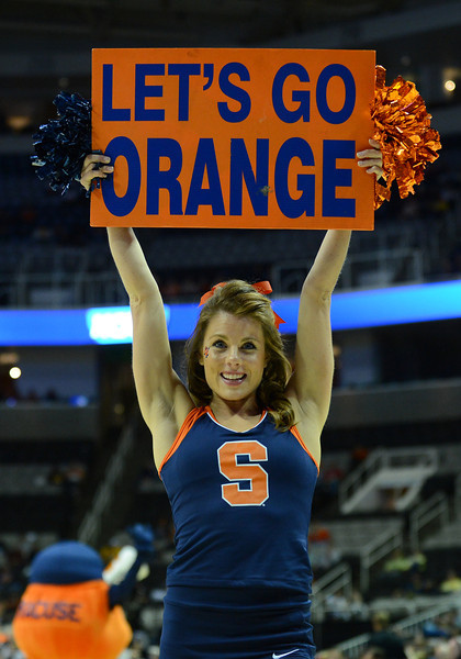 March 21, 2013: A Syracuse Orange cheerleader performs in a timeout during a game between the Syracuse Orangemen and the Montana Grizzlies in the second round of the NCAA Division I Men's Basketball Championship at HP Pavilion in San Jose, California.
