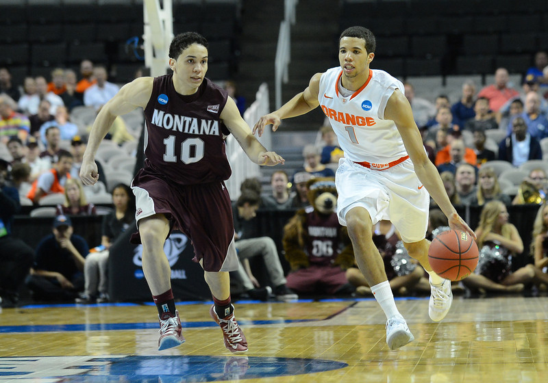 March 21, 2013: Syracuse Orange guard Michael Carter-Williams (1) brings the ball up the court against Montana Grizzlies guard Jordan Gregory (10) during a game between the Syracuse Orangemen and the Montana Grizzlies in the second round of the NCAA Division I Men's Basketball Championship at HP Pavilion in San Jose, California.