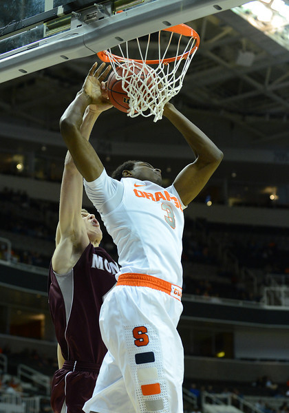 March 21, 2013: Montana Grizzlies center Andy Martin (41) blocks a dunk attempt by Syracuse Orange forward Jerami Grant (3) during a game between the Syracuse Orangemen and the Montana Grizzlies in the second round of the NCAA Division I Men's Basketball Championship at HP Pavilion in San Jose, California.