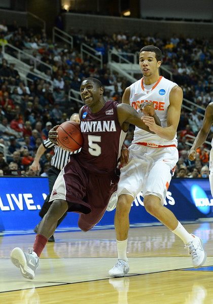 March 21, 2013: Montana Grizzlies guard Will Cherry (5) drives past Syracuse Orange guard Michael Carter-Williams (1) during a game between the Syracuse Orangemen and the Montana Grizzlies in the second round of the NCAA Division I Men's Basketball Championship at HP Pavilion in San Jose, California.