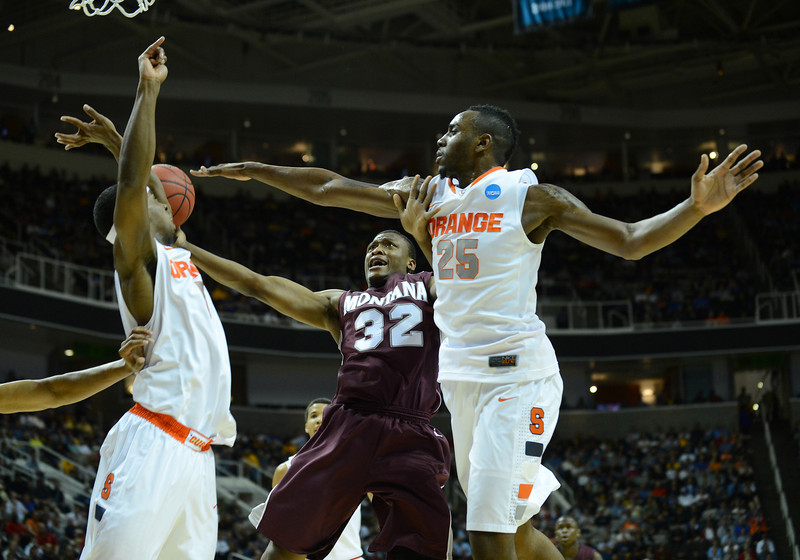 March 21, 2013: Montana Grizzlies guard/forward Kareem Jamar (32) puts up a contested shot during a game between the Syracuse Orangemen and the Montana Grizzlies in the second round of the NCAA Division I Men's Basketball Championship at HP Pavilion in San Jose, California.