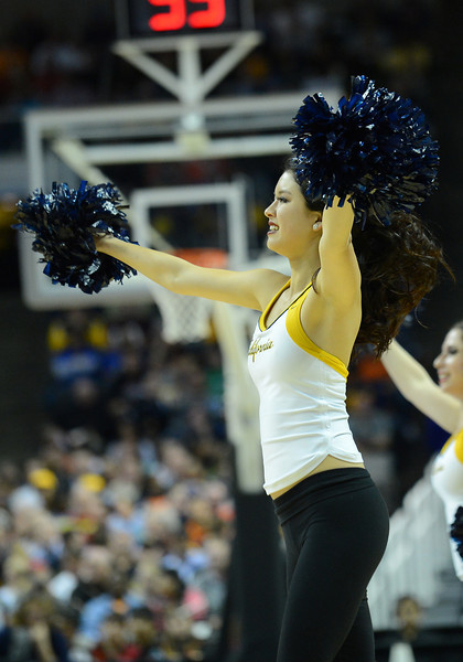 March 21, 2013: A California Golden Bears cheerleader performs in a timeout during a game between the UNLV Rebels and the Cal Golden Bears in the second round of the NCAA Division I Men's Basketball Championship at HP Pavilion in San Jose, California.