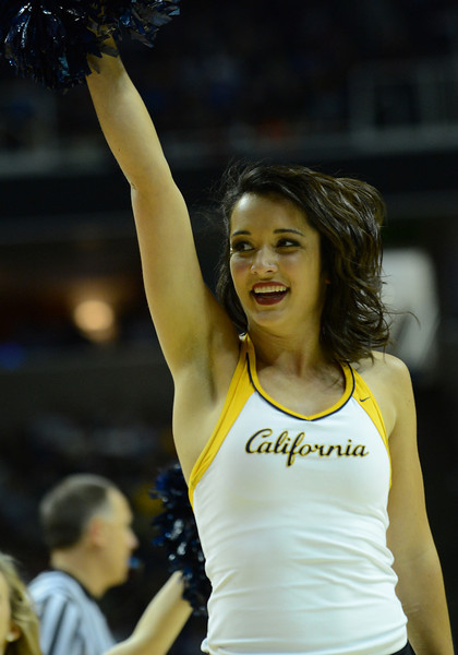 March 21, 2013: A California Golden Bears cheerleader performs in a timeoutduring a game between the UNLV Rebels and the Cal Golden Bears in the second round of the NCAA Division I Men's Basketball Championship at HP Pavilion in San Jose, California.