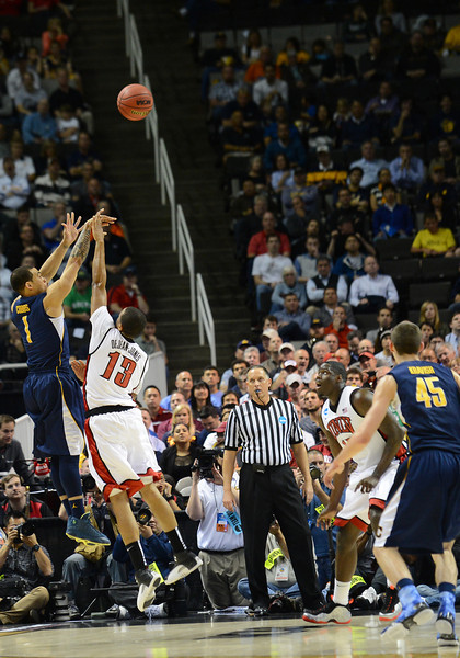 March 21, 2013: California Golden Bears guard Justin Cobbs (1) takes a shot during a game between the UNLV Rebels and the Cal Golden Bears in the second round of the NCAA Division I Men's Basketball Championship at HP Pavilion in San Jose, California.