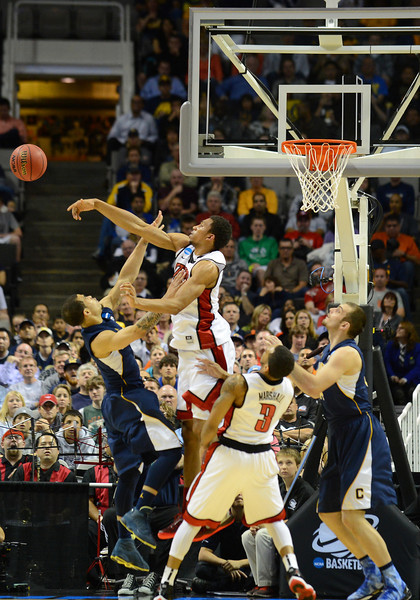 March 21, 2013: California Golden Bears guard Justin Cobbs (1) has his shot blocked during a game between the UNLV Rebels and the Cal Golden Bears in the second round of the NCAA Division I Men's Basketball Championship at HP Pavilion in San Jose, California.