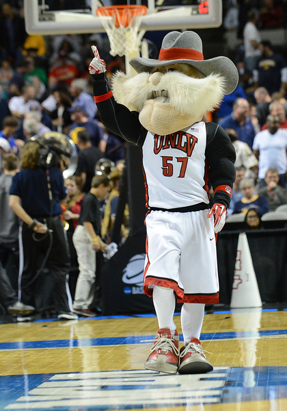 March 21, 2013: The UNLV Rebels mascot entertains the crowd in a timeout during a game between the UNLV Rebels and the Cal Golden Bears in the second round of the NCAA Division I Men's Basketball Championship at HP Pavilion in San Jose, California.