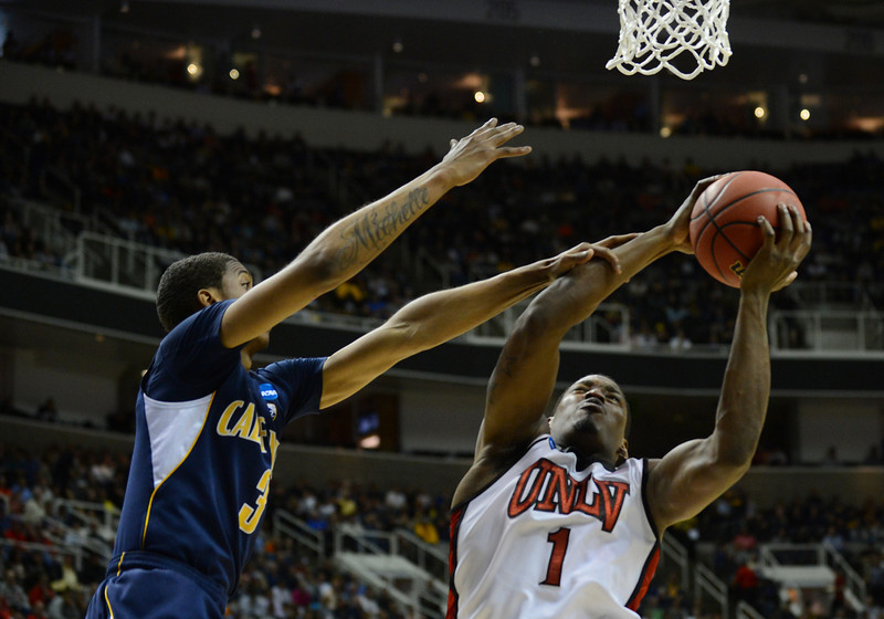 March 21, 2013: UNLV Rebels forward Quintrell Thomas (1) grabs a rebound during a game between the UNLV Rebels and the Cal Golden Bears in the second round of the NCAA Division I Men's Basketball Championship at HP Pavilion in San Jose, California.