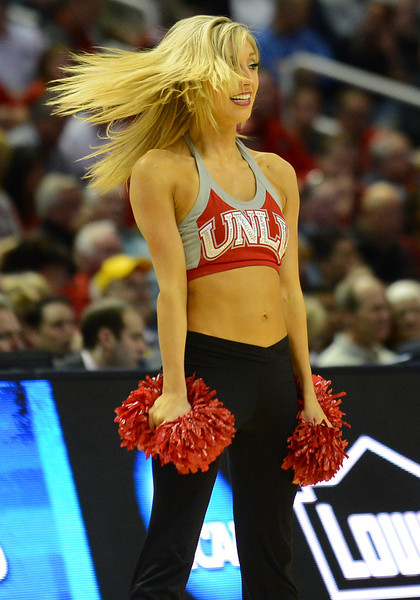 March 21, 2013: A UNLV Rebels cheerleader performs in a timeout during a game between the UNLV Rebels and the Cal Golden Bears in the second round of the NCAA Division I Men's Basketball Championship at HP Pavilion in San Jose, California.