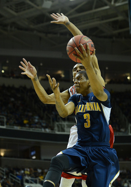 March 21, 2013: California Golden Bears guard Tyrone Wallace (3) drives past a UNLV Rebels defender during a game between the UNLV Rebels and the Cal Golden Bears in the second round of the NCAA Division I Men's Basketball Championship at HP Pavilion in San Jose, California.