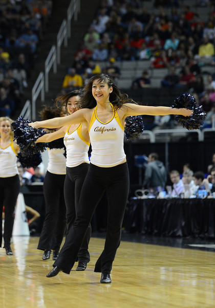 March 21, 2013: California Golden Bears cheerleaders perform in a timeout during a game between the UNLV Rebels and the Cal Golden Bears in the second round of the NCAA Division I Men's Basketball Championship at HP Pavilion in San Jose, California.