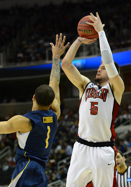 March 21, 2013: UNLV Rebels guard Katin Reinhardt (5) shoots over California Golden Bears guard Justin Cobbs (1) during a game between the UNLV Rebels and the Cal Golden Bears in the second round of the NCAA Division I Men's Basketball Championship at HP Pavilion in San Jose, California.