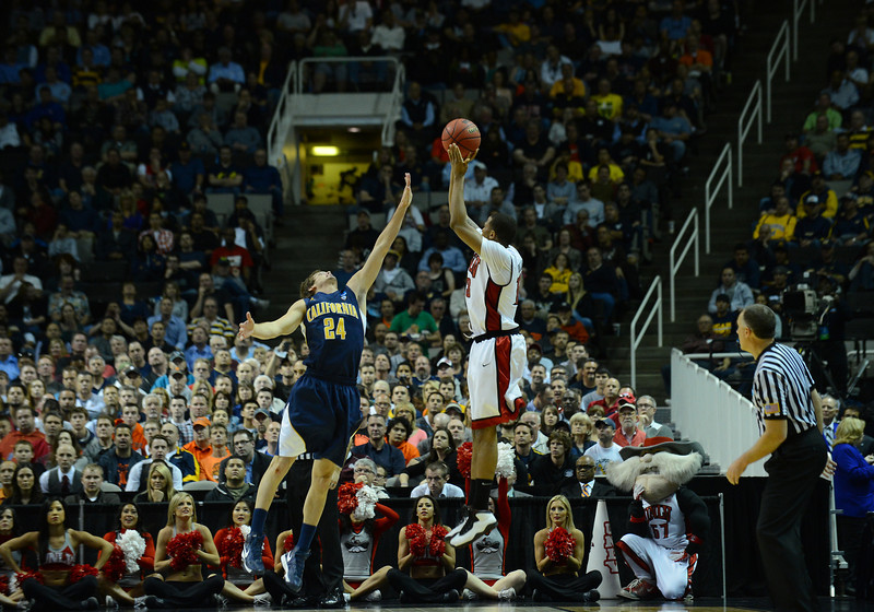 March 21, 2013: UNLV Rebels guard Bryce Dejean-Jones (13) shoots over California Golden Bears guard Ricky Kreklow (24) during a game between the UNLV Rebels and the Cal Golden Bears in the second round of the NCAA Division I Men's Basketball Championship at HP Pavilion in San Jose, California.