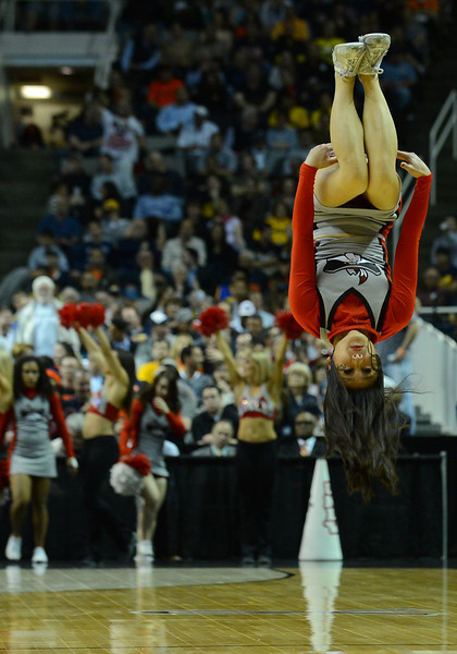 March 21, 2013: A UNLV Rebels cheerleader performs a tumbling routine in a timeout during a game between the UNLV Rebels and the Cal Golden Bears in the second round of the NCAA Division I Men's Basketball Championship at HP Pavilion in San Jose, California.