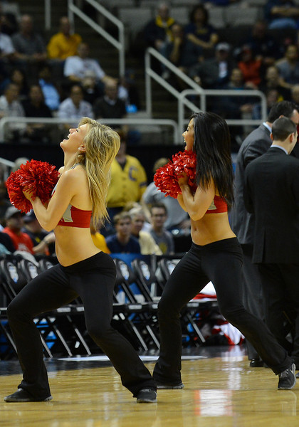 March 21, 2013: UNLV Rebels cheerleaders perform in a timeout during a game between the UNLV Rebels and the Cal Golden Bears in the second round of the NCAA Division I Men's Basketball Championship at HP Pavilion in San Jose, California.