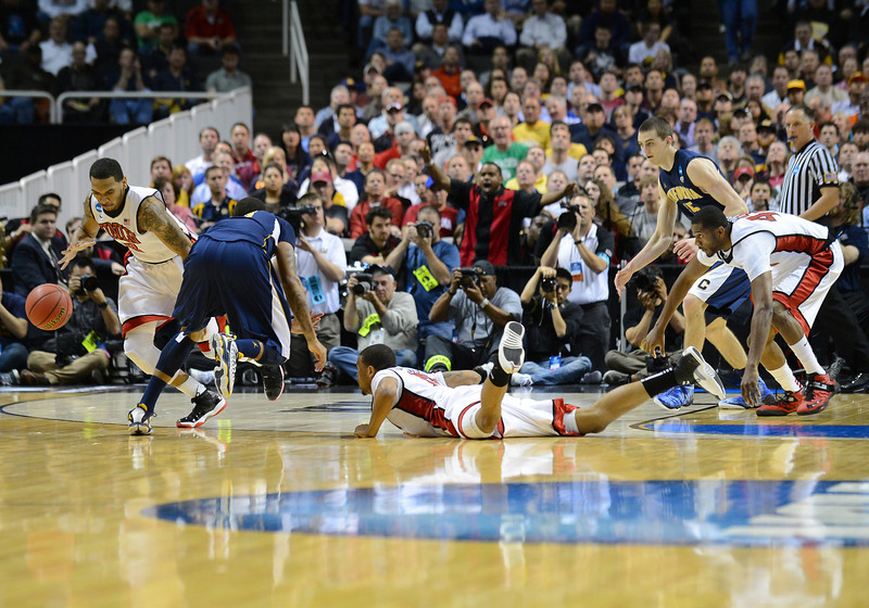 March 21, 2013: UNLV Rebels guard Anthony Marshall (3) grabs a loose ball during a game between the UNLV Rebels and the Cal Golden Bears in the second round of the NCAA Division I Men's Basketball Championship at HP Pavilion in San Jose, California.