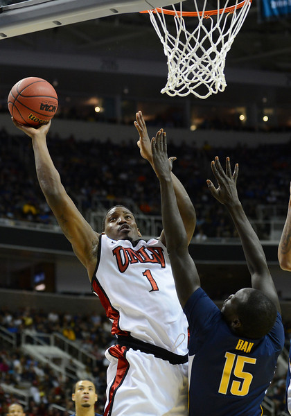 March 21, 2013: UNLV Rebels forward Quintrell Thomas (1) puts up a shot during a game between the UNLV Rebels and the Cal Golden Bears in the second round of the NCAA Division I Men's Basketball Championship at HP Pavilion in San Jose, California.