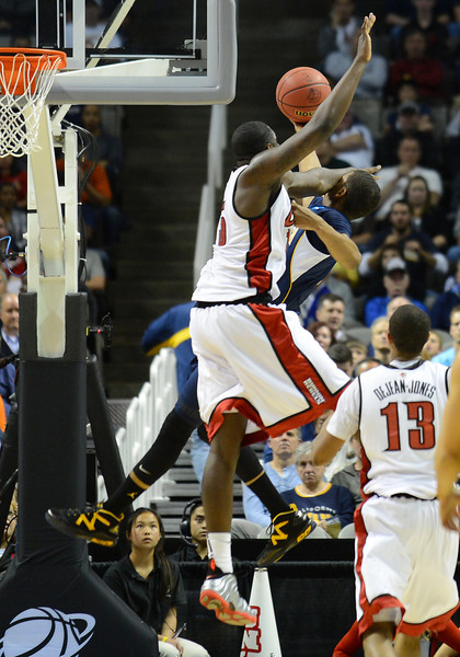 March 21, 2013: UNLV Rebels forward Anthony Bennett (15) fouls a California Golden Bears player during a game between the UNLV Rebels and the Cal Golden Bears in the second round of the NCAA Division I Men's Basketball Championship at HP Pavilion in San Jose, California.