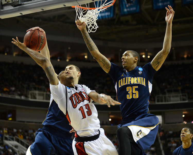 March 21, 2013: UNLV Rebels guard Bryce Dejean-Jones (13) has his layup attempt blocked during a game between the UNLV Rebels and the Cal Golden Bears in the second round of the NCAA Division I Men's Basketball Championship at HP Pavilion in San Jose, California.