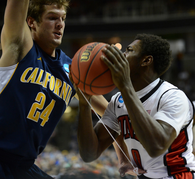 March 21, 2013: UNLV Rebels forward Savon Goodman (0) goes up against California Golden Bears guard Ricky Kreklow (24) during a game between the UNLV Rebels and the Cal Golden Bears in the second round of the NCAA Division I Men's Basketball Championship at HP Pavilion in San Jose, California.