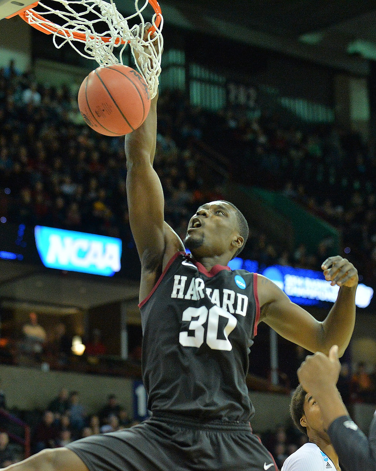 March 20, 2014: Harvard Crimson forward Kyle Casey (30) dunks during a second round game of the NCAA Division I Men's Basketball Championship between the 5-seed Cincinnati Bearcats and the 12-seed Harvard Crimson at Spokane Arena in Spokane, Wash. Harvard defeated Cincinnati 61-57.