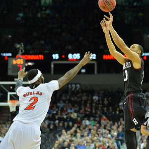 March 20, 2014: Harvard Crimson guard Brandyn Curry (10) shoots over Cincinnati Bearcats forward Titus Rubles (2) during a second round game of the NCAA Division I Men's Basketball Championship between the 5-seed Cincinnati Bearcats and the 12-seed Harvard Crimson at Spokane Arena in Spokane, Wash. Harvard defeated Cincinnati 61-57.