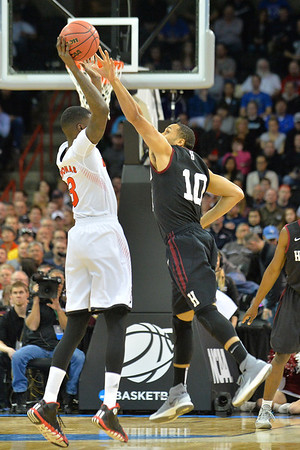 March 20, 2014: Harvard Crimson guard Brandyn Curry (10 defends Cincinnati Bearcats forward Shaquille Thomas (3) during a second round game of the NCAA Division I Men's Basketball Championship between the 5-seed Cincinnati Bearcats and the 12-seed Harvard Crimson at Spokane Arena in Spokane, Wash. Harvard defeated Cincinnati 61-57.