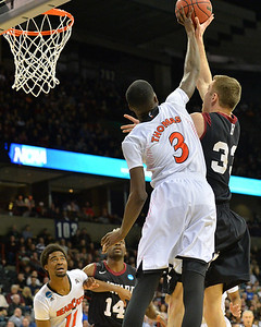 March 20, 2014: Cincinnati Bearcats forward Shaquille Thomas (3) blocks a shot attempt from Harvard Crimson forward Evan Cummins (33) during a second round game of the NCAA Division I Men's Basketball Championship between the 5-seed Cincinnati Bearcats and the 12-seed Harvard Crimson at Spokane Arena in Spokane, Wash. Harvard defeated Cincinnati 61-57.