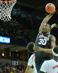 March 20, 2014: Harvard Crimson forward Kyle Casey (30) goes up for a dunk during a second round game of the NCAA Division I Men's Basketball Championship between the 5-seed Cincinnati Bearcats and the 12-seed Harvard Crimson at Spokane Arena in Spokane, Wash. Harvard defeated Cincinnati 61-57.