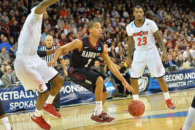March 20, 2014: Harvard Crimson guard Siyani Chambers (1) looks to get inside during a second round game of the NCAA Division I Men's Basketball Championship between the 5-seed Cincinnati Bearcats and the 12-seed Harvard Crimson at Spokane Arena in Spokane, Wash. Harvard defeated Cincinnati 61-57.