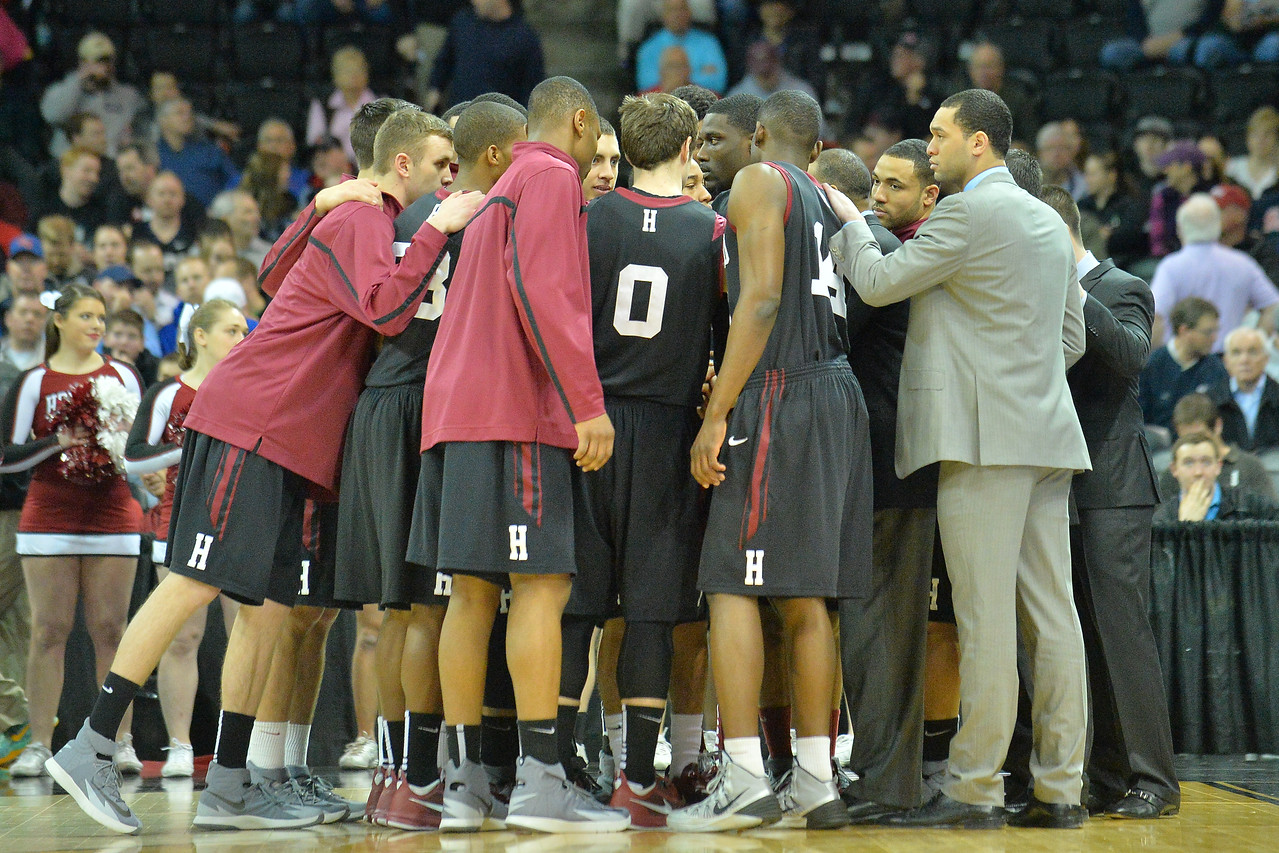 March 20, 2014: The Harvard Crimson team huddles before the tip-off a second round game of the NCAA Division I Men's Basketball Championship between the 5-seed Cincinnati Bearcats and the 12-seed Harvard Crimson at Spokane Arena in Spokane, Wash. Harvard defeated Cincinnati 61-57.