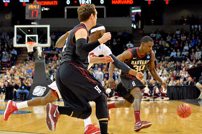 March 20, 2014: Harvard Crimson forward Kyle Casey (30) chases down a loose ball during a second round game of the NCAA Division I Men's Basketball Championship between the 5-seed Cincinnati Bearcats and the 12-seed Harvard Crimson at Spokane Arena in Spokane, Wash. Harvard defeated Cincinnati 61-57.