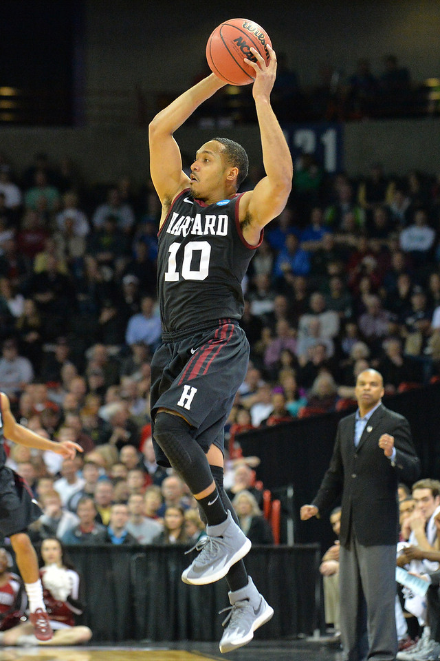 March 20, 2014: Harvard Crimson guard Brandyn Curry (10) grabs a high pass during a second round game of the NCAA Division I Men's Basketball Championship between the 5-seed Cincinnati Bearcats and the 12-seed Harvard Crimson at Spokane Arena in Spokane, Wash. Harvard defeated Cincinnati 61-57.