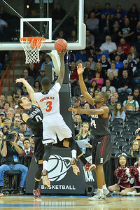 March 20, 2014: Cincinnati Bearcats forward Shaquille Thomas (3) shoots over Harvard Crimson guard Laurent Rivard (0) during a second round game of the NCAA Division I Men's Basketball Championship between the 5-seed Cincinnati Bearcats and the 12-seed Harvard Crimson at Spokane Arena in Spokane, Wash. Harvard defeated Cincinnati 61-57.