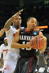 March 20, 2014: Harvard Crimson guard Brandyn Curry (10) looks to get past the Cincinnati Bearcats defense during a second round game of the NCAA Division I Men's Basketball Championship between the 5-seed Cincinnati Bearcats and the 12-seed Harvard Crimson at Spokane Arena in Spokane, Wash. Harvard defeated Cincinnati 61-57.