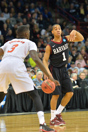 March 20, 2014: Harvard Crimson guard Siyani Chambers (1) calls a play during a second round game of the NCAA Division I Men's Basketball Championship between the 5-seed Cincinnati Bearcats and the 12-seed Harvard Crimson at Spokane Arena in Spokane, Wash. Harvard defeated Cincinnati 61-57.
