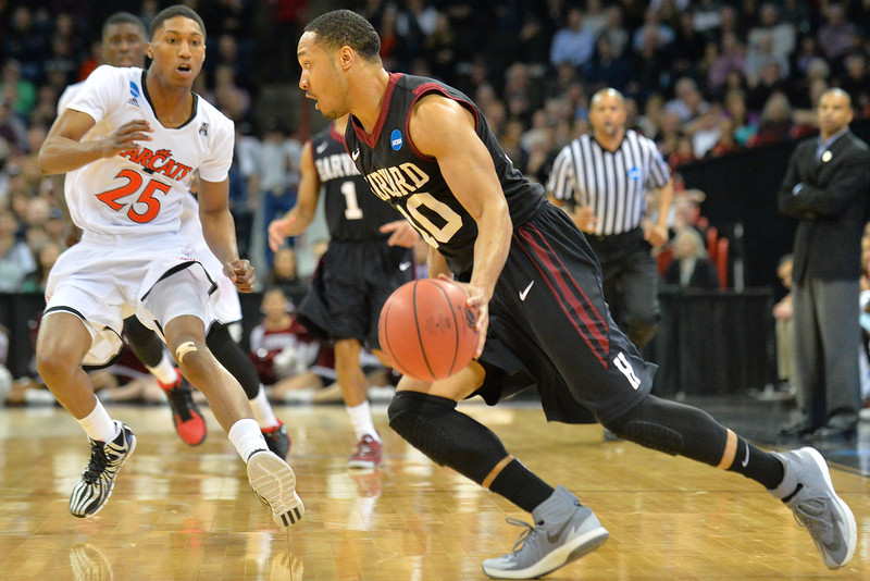 March 20, 2014: Harvard Crimson guard Brandyn Curry (10) dribbles during a second round game of the NCAA Division I Men's Basketball Championship between the 5-seed Cincinnati Bearcats and the 12-seed Harvard Crimson at Spokane Arena in Spokane, Wash. Harvard defeated Cincinnati 61-57.