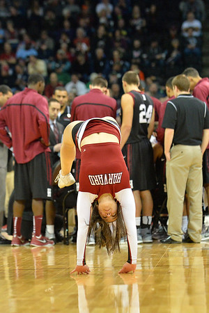 March 20, 2014: A Harvard Crimson cheerleader performs during a second round game of the NCAA Division I Men's Basketball Championship between the 5-seed Cincinnati Bearcats and the 12-seed Harvard Crimson at Spokane Arena in Spokane, Wash. Harvard defeated Cincinnati 61-57.