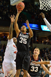 March 20, 2014: Harvard Crimson guard/forward Agunwa Okolie (35) gets a layup during a second round game of the NCAA Division I Men's Basketball Championship between the 5-seed Cincinnati Bearcats and the 12-seed Harvard Crimson at Spokane Arena in Spokane, Wash. Harvard defeated Cincinnati 61-57.