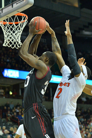 March 20, 2014: Cincinnati Bearcats forward Titus Rubles (2) blocks a shot during a second round game of the NCAA Division I Men's Basketball Championship between the 5-seed Cincinnati Bearcats and the 12-seed Harvard Crimson at Spokane Arena in Spokane, Wash. Harvard defeated Cincinnati 61-57.