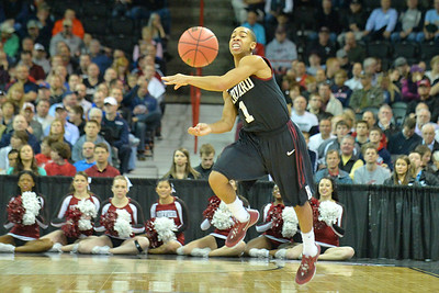 March 20, 2014: Harvard Crimson guard Siyani Chambers (1) passes the ball on a fast break during a second round game of the NCAA Division I Men's Basketball Championship between the 5-seed Cincinnati Bearcats and the 12-seed Harvard Crimson at Spokane Arena in Spokane, Wash. Harvard defeated Cincinnati 61-57.