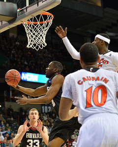 March 20, 2014: Harvard Crimson forward Steve Moundou-Missi (14) goes up for a layup during a second round game of the NCAA Division I Men's Basketball Championship between the 5-seed Cincinnati Bearcats and the 12-seed Harvard Crimson at Spokane Arena in Spokane, Wash. Harvard defeated Cincinnati 61-57.