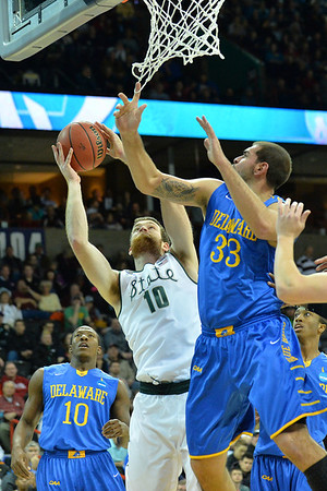 March 20, 2014: Michigan State Spartans forward Matt Costello (10) puts up a shot attempt during a second round game of the NCAA Division I Men's Basketball Championship between the 4-seed Michigan State and the 13-seed Delaware at Spokane Arena in Spokane, Wash. Michigan State defeated Delaware 93-78.