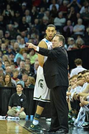 March 20, 2014: Michigan State Spartans head coach Tom Izzo talks to Michigan State Spartans guard Denzel Valentine (45) during a second round game of the NCAA Division I Men's Basketball Championship between the 4-seed Michigan State and the 13-seed Delaware at Spokane Arena in Spokane, Wash. Michigan State defeated Delaware 93-78.