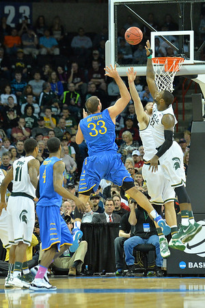 March 20, 2014: Michigan State Spartans guard/forward Branden Dawson (22) contests a shot attempt from Delaware Fightin' Blue Hens forward Carl Baptiste (33) during a second round game of the NCAA Division I Men's Basketball Championship between the 4-seed Michigan State and the 13-seed Delaware at Spokane Arena in Spokane, Wash. Michigan State defeated Delaware 93-78.