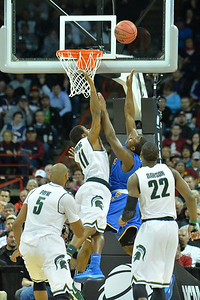 March 20, 2014: Michigan State Spartans guard Keith Appling (11) contests a shot attempt during a second round game of the NCAA Division I Men's Basketball Championship between the 4-seed Michigan State and the 13-seed Delaware at Spokane Arena in Spokane, Wash. Michigan State defeated Delaware 93-78.