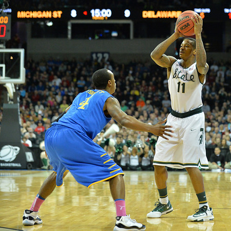 March 20, 2014: Michigan State Spartans guard Keith Appling (11) looks to pass inside during a second round game of the NCAA Division I Men's Basketball Championship between the 4-seed Michigan State and the 13-seed Delaware at Spokane Arena in Spokane, Wash. Michigan State defeated Delaware 93-78.