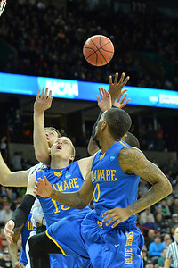 March 20, 2014: Michigan State Spartans forward Matt Costello (10), Delaware Fightin' Blue Hens guard Kyle Anderson (13) and Delaware Fightin' Blue Hens guard Davon Usher (0) fight for a rebound during a second round game of the NCAA Division I Men's Basketball Championship between the 4-seed Michigan State and the 13-seed Delaware at Spokane Arena in Spokane, Wash. Michigan State defeated Delaware 93-78.